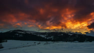 Stock Video Footage of Timelapse of clouds passing by over winter landscape in Carpathian at sunset