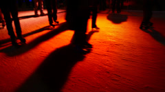Shadows of ice skaters on orange. Stock Footage