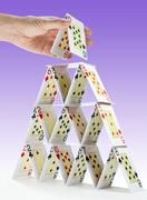 completing a house of cards - stock photo