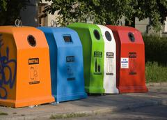Different color recycling containers Stock Photos
