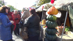 People autumn goods stall women tastes farmers prepared food Stock Footage