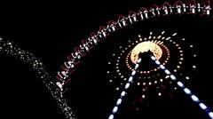 Illuminated ferris wheel in the night. Stock Footage