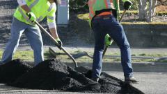 Road Work 1 - shoveling asphalt Stock Footage