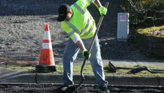 Road Work 2 - shoveling asphalt Stock Footage