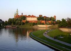 Poland, krakow, people resting by vistula river, wawel hill Stock Photos
