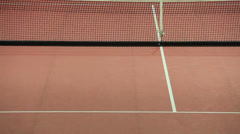 Tennis players on indoor court Stock Footage