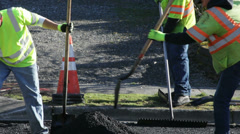 Road Work 3 - shoveling asphalt Stock Footage