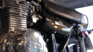 Stock Video Footage of Kawasaki 900 Motorcycle Engine rack focus