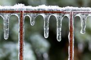 Stock Photo of Icicles on a rusted fence after an ice storm.