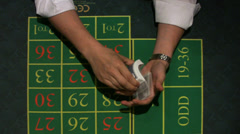 Dealing cards in Casino. Croupier dealing cards on green table. Stock Footage