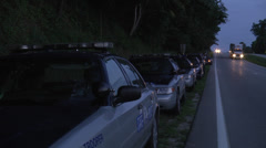 Police search team vehicles by highway Stock Footage