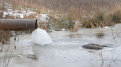 River Pollution, Garbage in Water. Winter Stock Footage