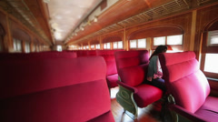 Woman travelling alone in train Stock Footage