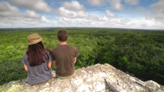 Couple on top of a maya temple Stock Footage