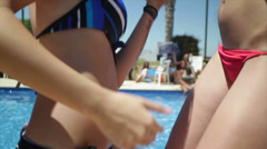 Sexy girls dancing at a pool party - stock footage