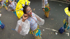 Body shake of fan headress street dancers Stock Footage