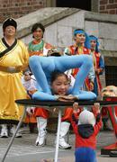 Mongolian street performers at main market square, krakow poland Stock Photos