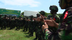 Indonesian Soldiers clap and chant Stock Footage