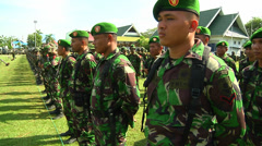 Indonesian Soldiers stand at attention in Poso Stock Footage