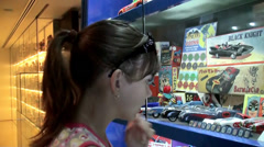 Girl at the showcase with rare vintage toys. Stock Footage