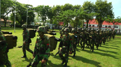 Indonesian Soldiers march Wide Shot Stock Footage