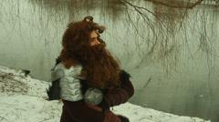 Viking man looking ice lake Stock Footage