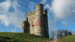 Imposing astle next to lone man (dolly) Stock Footage