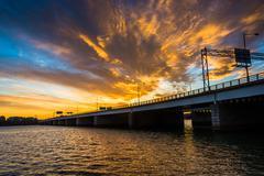 sunset over the potomac river and george mason memorial bridge in washington, - stock photo