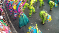 Stock Video Footage of bending forward of street dancers in bamboo and flower costume