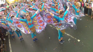 Stock Video Footage of raising wings of butterfly costumed street dancer
