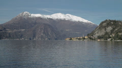 Stock Video Footage of Across Lake Como Snow Peaked Mountains in background