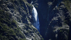 Waterfall cascading down from mountains, New Zealand. Stock Footage