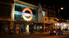 Front of Brixton Tube Station at night Stock Footage