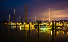 boats in a marina at night, in havre de grace, maryland. - stock photo