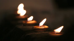 Beautiful oil candles at night - stock footage