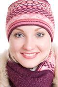 Girl dressed in winter cap, coat, mittens Stock Photos