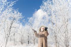 A girl throwing up snow Stock Photos