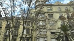 High angle POV drive past of period buildings in Barcelona Stock Footage