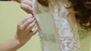 Stock Video Footage of Buttoning wedding dress