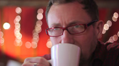 Man drinks coffee in cafe Stock Footage