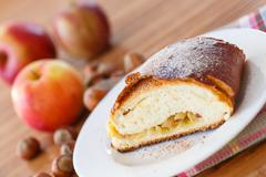 Sweet strudel with apples Stock Photos