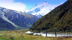 New Zealand valley, snow capped mountains, river in the foreground. Stock Footage