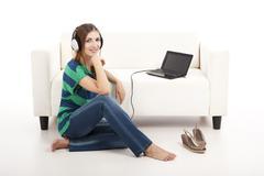 listen music on a laptop - stock photo