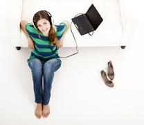 Stock Photo of listen music on a laptop