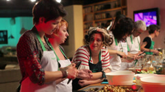 People prepare food at the long table Stock Footage