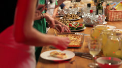 People cook food at a long table Stock Footage