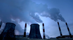 Smoke from pipe of thermal power station in winter sunset. Timelaps. - stock footage