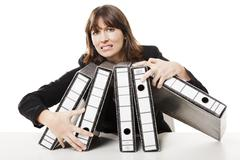 stressed woman at the office - stock photo