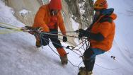 Stock Video Footage of Alpinist at slope climbs to Everest mountain top