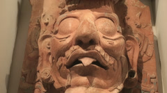 Mayan face carved in stone Stock Footage